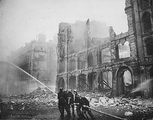 Firefighters working after a Saturday night air raid in 1941.