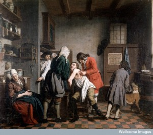 L0010649 Interior with a surgeon attending to a wound in a man's side